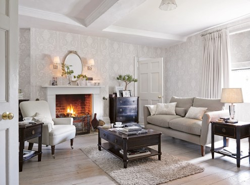 Living room with fireplace and sofa in grey shades