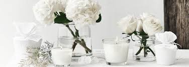 White candles and white flowers