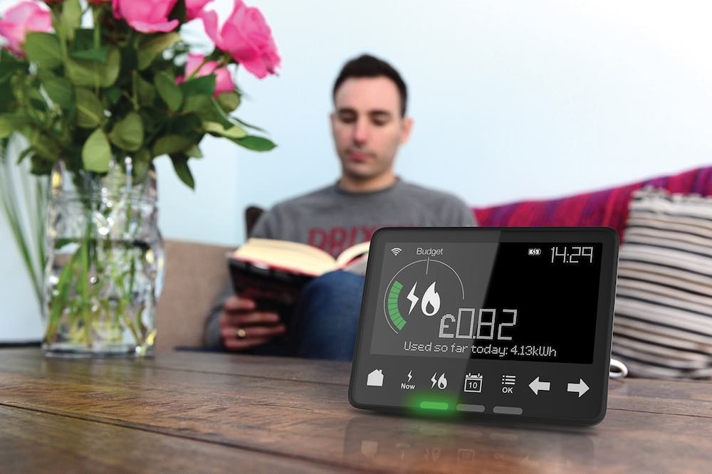 A man sitting with his Npower smart meter